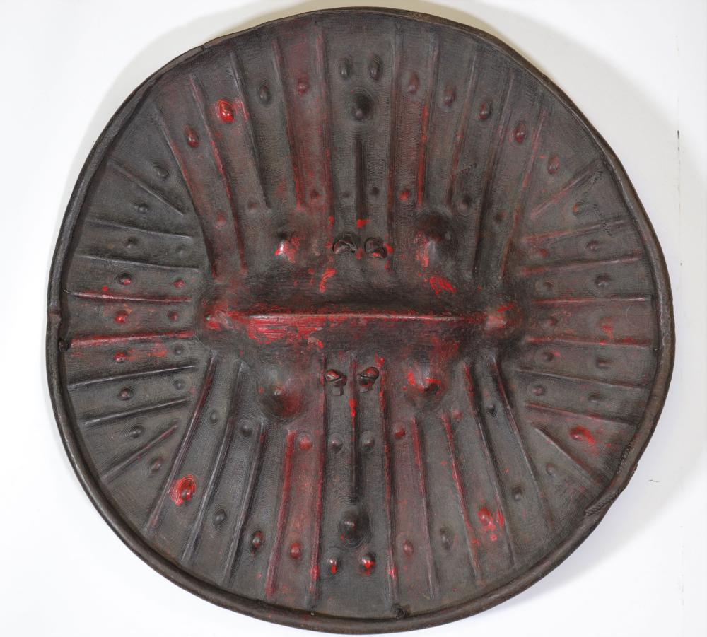 Rare imposing circular shield in black leather with embossed radiating patterns. Ethiopia. Size