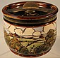 A Royal Doulton tobacco jar, painted with a
