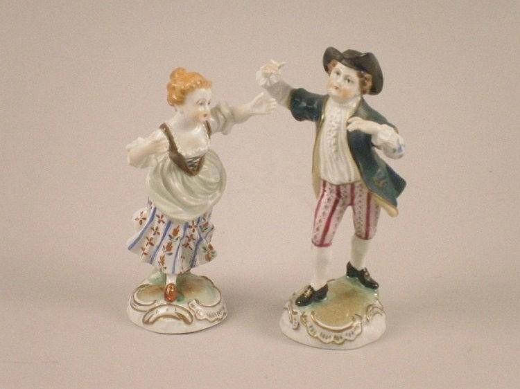 A pair of 20thC Dresden porcelain figures of a man