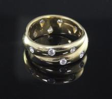 A modern Tiffany & Co 18ct gold, platinum and diamond Etoile ring, size K.