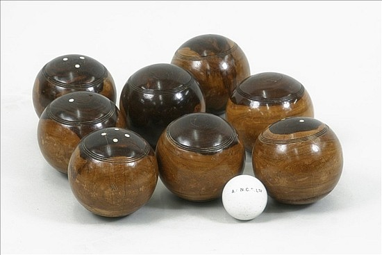 A set of eight Victorian lignum vitae lawn bowls,