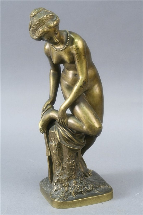 *A bronze bather, signed Coinchon