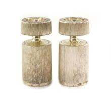 A pair of textured silver salt and pepper mills by Adrian Gerald Benney
