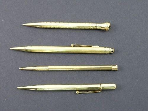 A Bakers Perm-Point 9ct gold propelling pencil, another with engine turned decoration, a gold filled Nupoint and a gilt metal plated pencil by Eversharp (4)