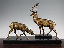 Jules Edmond Masson. A patinated bronze figure group of a stag and doe, 20in.