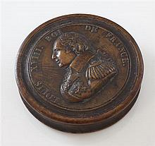 An early 19th century French yew wood press moulded circular snuff box, 3.25in.