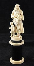 A 19th century Dieppe ivory carving of a beggar woman suckling a child, 8.5in.