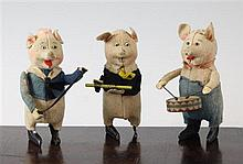 Three Schuco clockwork musical pigs, 4.75in.