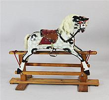 A 20th century dapple grey rocking horse, approx. 48in.