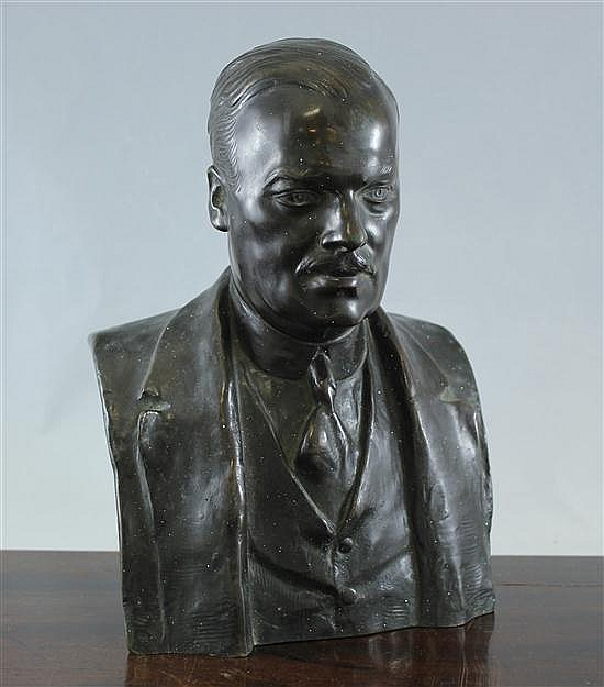 A bronze bust of a gentleman, 11ins