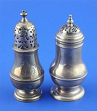 Two George I Brittania standard silver pepperettes, 4.5in & 4.25in respectively.