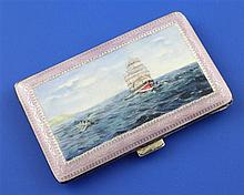 A 1920's continental silver and enamel cigarette case, the lid with shipping scene after Somerscales, 3.25in.