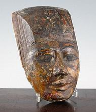 A carved wood mask (head of a sarcophagus) probably Thebes, 9in.