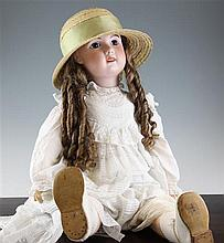 An early 20th century French Bebe Jumeau bisque head doll,