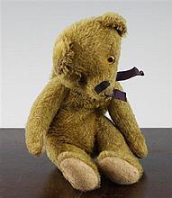 A 20th century teddy bear purse, 9in.