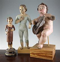 A 19th / 20th century Spanish painted pine figure of a musical putto, largest 19.5in.