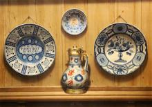 § Frederick Clifford Harrison (1901-1984) Delftware plates and a jug 21.25 x 30in.