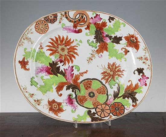 A Chinese export pseudo tobacco leaf famille rose dish