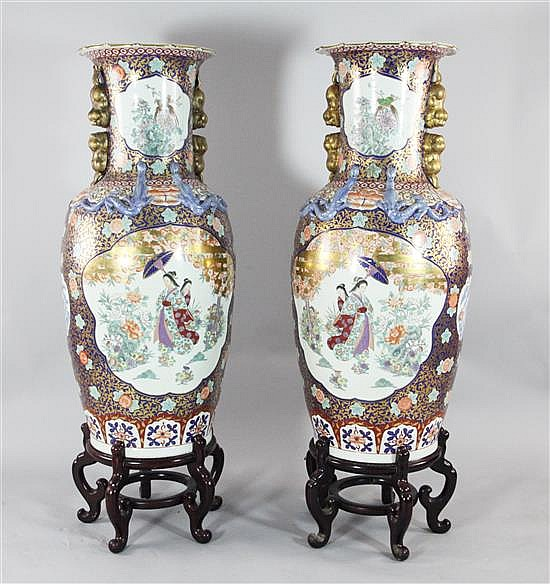 A pair of massive Chinese famille rose vases, 42in.; wood stands