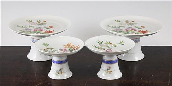 Two pairs of Chinese famille rose stem dishes