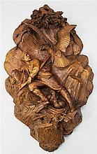Johann Huggler, Brienz (Swiss 1834-1912). A Black Forest carved linden wood wall plaque, W.1ft 10in. H.3ft 2in.