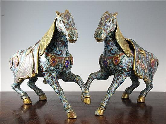 A pair of large Chinese cloisonne enamel figures of prancing horses, 14.5 x 18.75in.