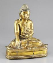 A Burmese bronze seated figure of Buddha, 19th / 20th century, 25.5cm, casting faults