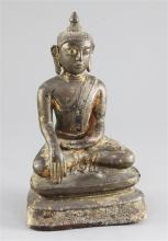 A Burmese gilt lacquered bronze seated figure of Buddha, Shan period, 18th century, 23cm