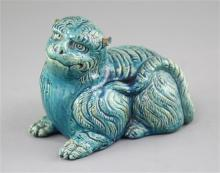 A Japanese turquoise glazed pottery model of a recumbent lion, c.1900, length 18cm