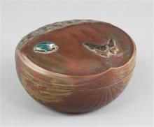 A Japanese patinated bronze and enamel box and cover, modelled as a chestnut, Meiji period, width 11cm