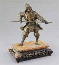 A Japanese parcel gilt bronze figure of a samurai, Meiji period, total height 27cm, replacement spear