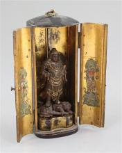 A Japanese lacquer 'Zushi' (portable shrine), 19th century, total height 20.5cm, losses to figure