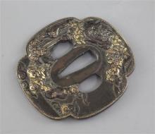 A Japanese parcel gilt bronze tsuba, 19th century, 7.2cm