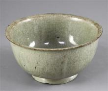 A celadon lobed bowl, possibly Korean, Goryeo dynasty (12th century), old gilt repairs to rim chips, diameter 15.5cm
