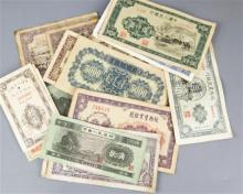 A collection of old Chinese bank notes