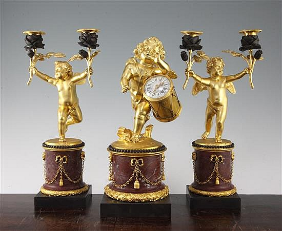 A French ormolu and rouge marble clock garniture, candelabra 13.25in.
