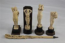 Four 1930's Indian ivory figures of nude women & a parasol handle