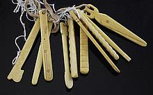 A collection of ten 19th century carved ivory teething tools, approx 3.75in.