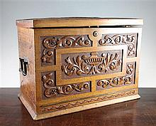 A late Victorian carved walnut travelling desk compendium, overall 17in.