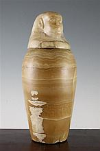 An ancient Egyptian alabaster canopic jar and cover, 16th-4th century BC, 15.25in., repairs to cover