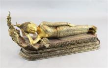 A large Thai gilt and polychrome bronze reclining figure of Buddha, possibly Mandalay period, 19th century, length approx. 132cm, heigh