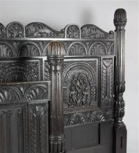 A 17th century style ebonised oak bedstead, W.6ft 10in. D.7ft 4in. H.4ft approx.