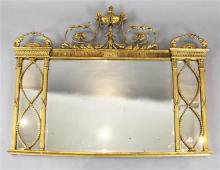 An Adam Revival giltwood and gesso overmantel, W.4ft 1in. H.2ft 10in.