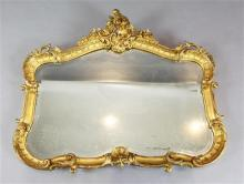 A French giltwood and gesso cartouche shaped wall mirror, W.3ft 9in. H.3ft