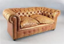 A pair of 1930's buttoned pale russet leather Chesterfield settees, W.5ft 9in. D.3ft. H.2ft 5in.