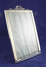 An Edwardian silver ribbon top photograph frame, overall 13.5in.