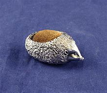 A 1980's novelty silver pin cushion, modelled as a hedgehog, 2.25in.