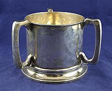 An Edwardian large silver tyg, 18 oz.
