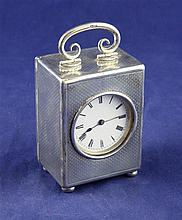 An early 20th century continental engine turned silver miniature carriage timepiece, 2.5in.