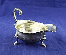 A mid 18th century silver sauceboat, 8 oz.